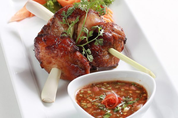 Grilled marinated chicken thigh with crunchy vegetables and spicy e-sarn sauce